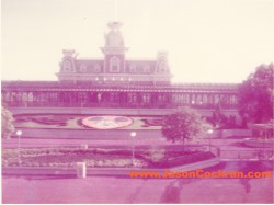 Floral clock area and Main Street Station outside Magic Kingdom, Walt Disney World, as seen from the monorail. July 1973