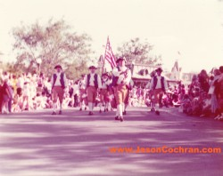 Patriotic parade at Magic Kingdom, Walt Disney World. The Swan Boats station is behind the marchers. Mid-1970s