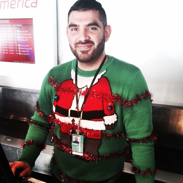 On one of the busiest travel days of the year, you can either grouse and grumble and fight your way through it or you can deck yourself out like this spirited @VirginAmerica check-in agent. Sometimes, playing merry is a gift you give to yourself. #LosAngeles #travel #airport #LAX #VirginAmerica #Christmas