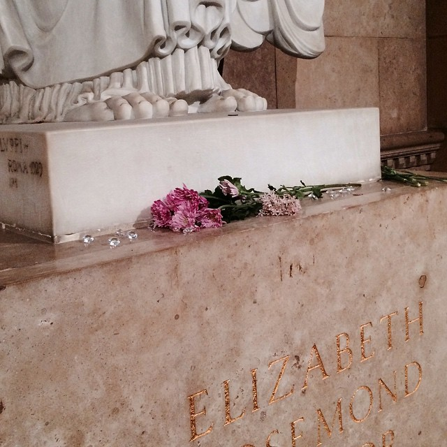 False diamonds and dead flowers at the feet of the angel at Elizabeth Taylor's tomb. #LosAngeles #California