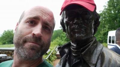 Jason Cochran and statue of Thomas Jefferson